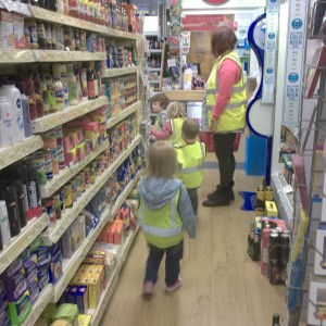 We make regular visits around the local area. We always wear our high visibility jackets to keep us safe. Here we are at the Post Office where we used real money to buy things.